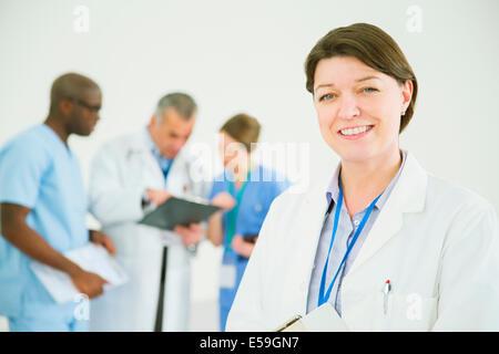 Portrait of confident doctor - Stock Photo