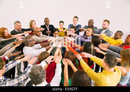 Business people connecting hands in huddle - Stock Photo