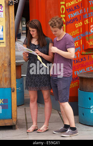 Young couple looking at map at London in July - Stock Photo