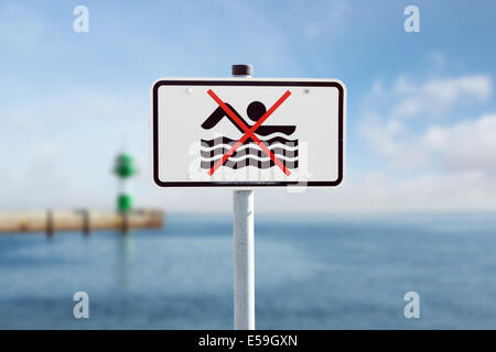 bathing prohibition sign on the Baltic Sea - Stock Photo