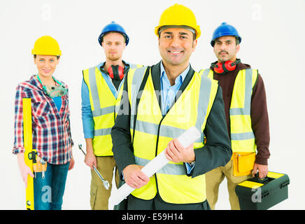 Portrait of confident construction workers - Stock Photo