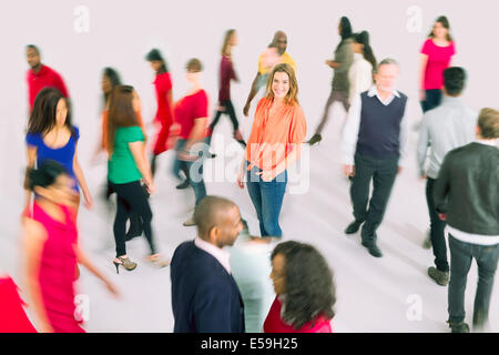 Portrait of businesswoman standing out from the crowd - Stock Photo