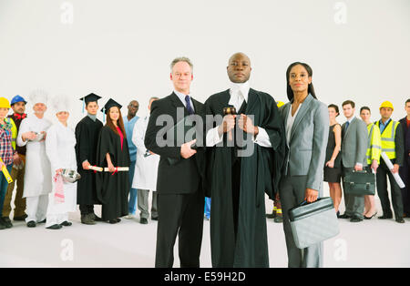 Workforce behind confident lawyers and judge - Stock Photo