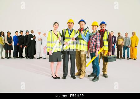 Portrait of confident construction workers - Stock Photo