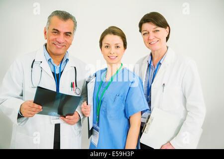 Portrait of confident doctors and nurse - Stock Photo