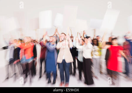 Protesters waving picket signs - Stock Photo