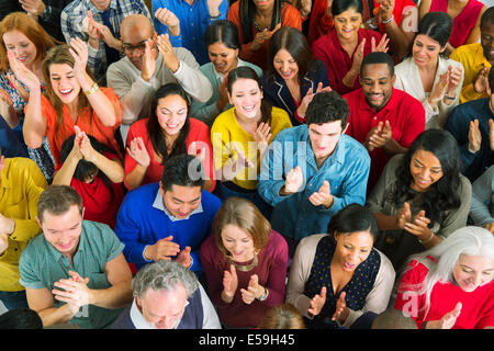 Diverse crowd clapping - Stock Photo