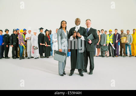Workforce behind confident judge and lawyers - Stock Photo