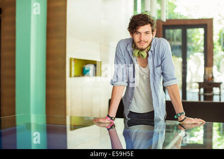 Man leaning on desk in office - Stock Photo