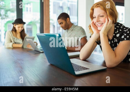 People working on laptops in office - Stock Photo