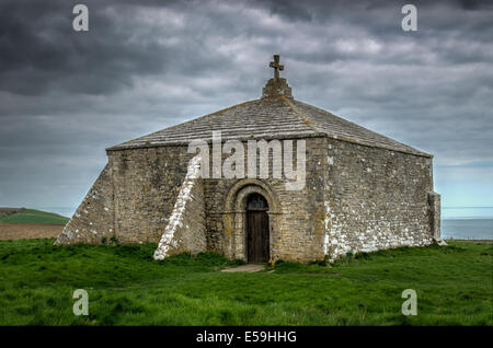 St Aldhelm's Chapel is a Norman chapel on St Aldhelm's Head in the parish of Worth Matravers, Swanage, Dorset. England, - Stock Photo