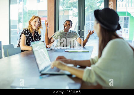 People working at conference table in office - Stock Photo