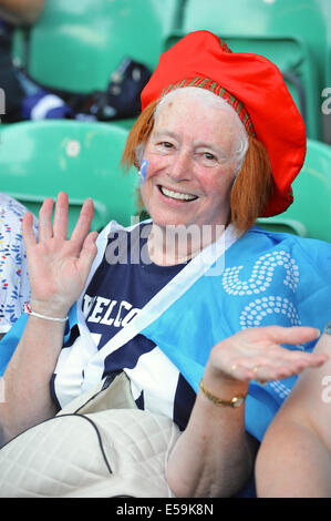 Glasgow, Scotland, UK. 23rd July, 2014. Colourfully dressed spectators at the opening ceremony of the XX Commonwealth - Stock Photo