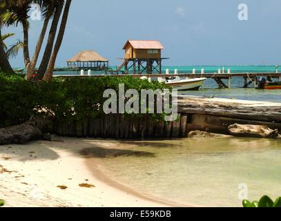 Docks, boats and the beach on Ambergris Caye in Belize - Stock Photo