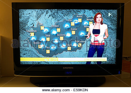 Television weather presenter giving the forecast for Hungary, showing stormy weather ahead. Hungary. - Stock Photo