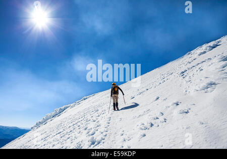 Climber on the way to the top of an active volcano Villarica in Chile. - Stock Photo