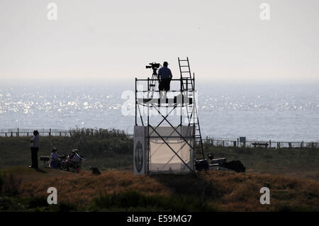Porthcawl, Wales, UK. 24th July, 2014. TV camera man taking in the sea views  during day one of The Senior Open - Stock Photo