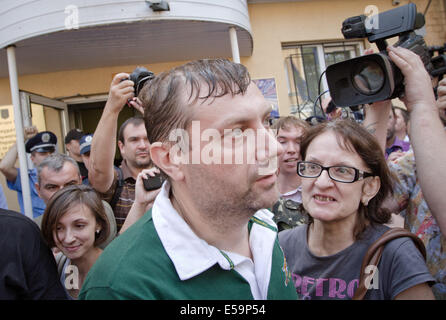Kiev, Ukraine. 24th July, 2014. JULY 24: Civil advocate of Communist Party leaves the building of Kiev county administrative - Stock Photo