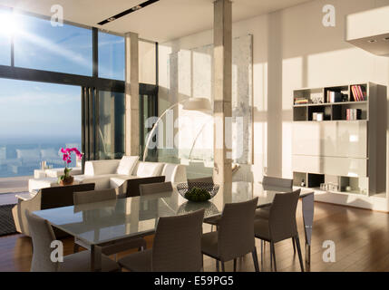 Dining and living space in modern house - Stock Photo
