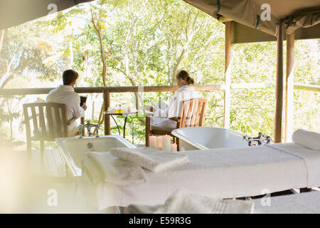 Couple relaxing together in spa - Stock Photo
