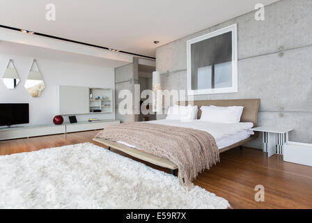 Shag rug in modern bedroom - Stock Photo