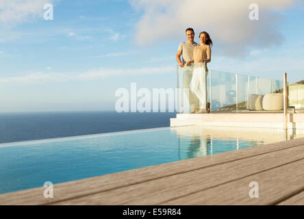 Woman by railing overlooking ocean stock photo royalty for Balcony overlooking ocean