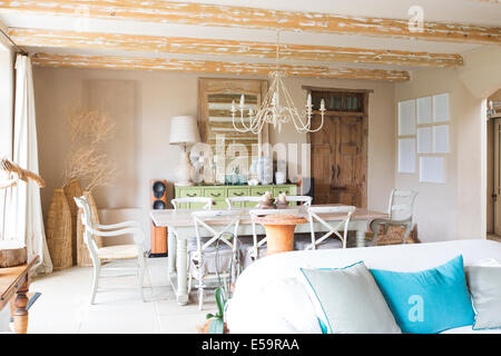 Living and dining area in rustic house - Stock Photo