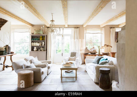 Sofas and coffee table in rustic living room - Stock Photo
