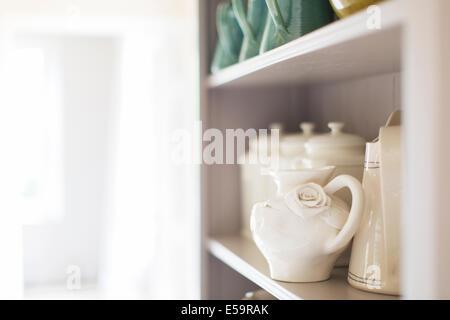 Close up of ceramics on kitchen shelf - Stock Photo