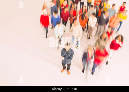 Businessman standing out from the crowd - Stock Photo
