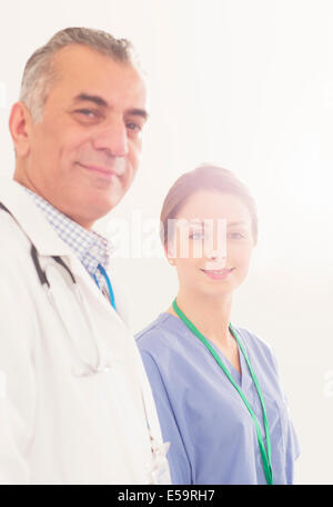 Portrait of confident doctor and nurse - Stock Photo