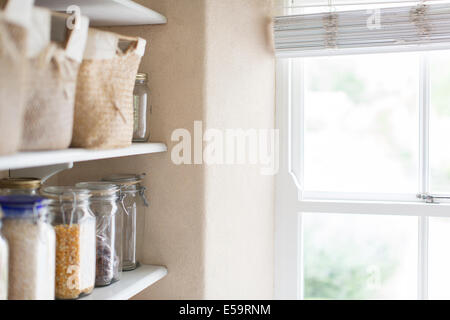 Dry goods and window of pantry - Stock Photo