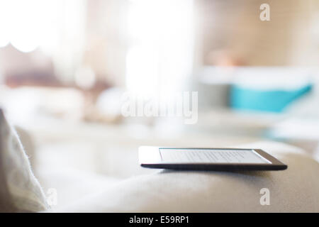 Tablet reader on sofa - Stock Photo
