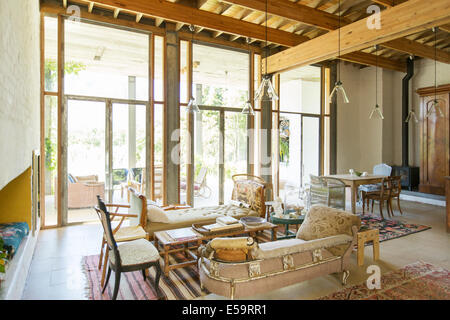 Living and dining area of rustic house - Stock Photo
