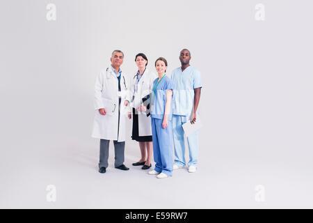 Portrait of confident doctors and nurses - Stock Photo