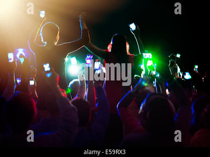 Audience enjoying concert - Stock Photo