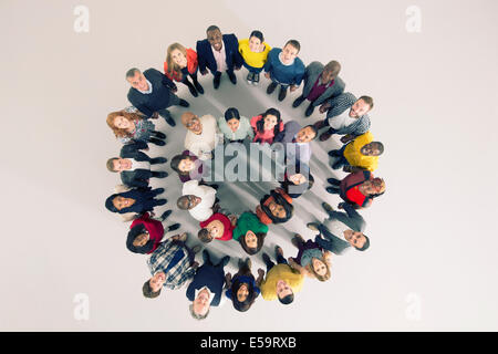 Portrait of diverse crowd in huddle - Stock Photo