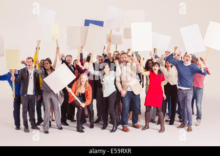 Protesters with picket signs - Stock Photo