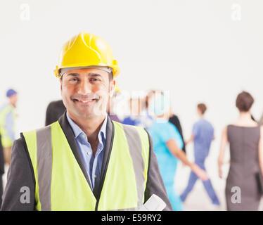 Portrait of confident construction worker - Stock Photo