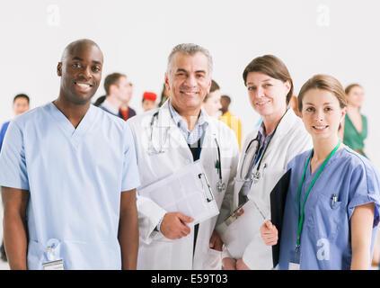 Portrait of smiling doctors and nurses - Stock Photo