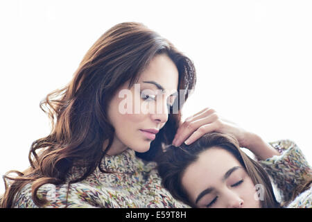 Mother hugging child - Stock Photo