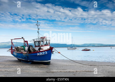 A fishing boat ashore at high tide in Aberdovey, Aberdyfi - Stock Photo