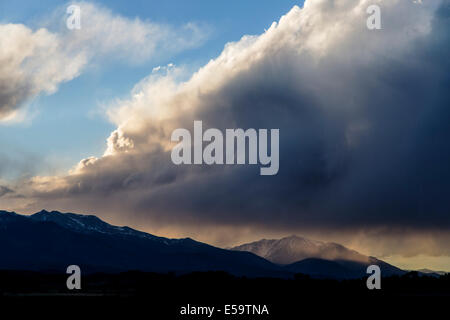 Dramatic sunlight and clouds over Central Colorado Rocky Mountains, USA - Stock Photo