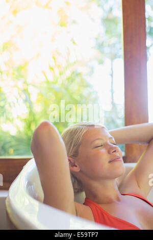 Woman relaxing in hot tub - Stock Photo