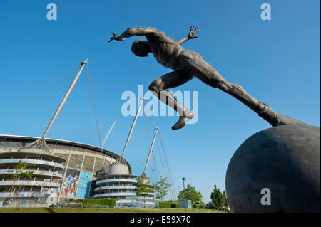 A statue of a sprinter the moment after the starting pistol near to the City of Manchester Etihad Stadium (Editorial - Stock Photo