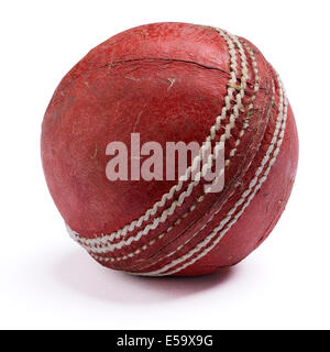 Old worn out red leather cricket ball - Stock Photo