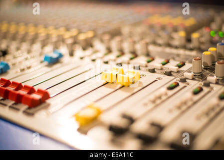 Slider on a sound mixer with blurs - Stock Photo