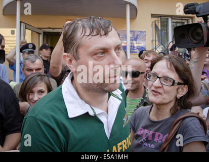 Kiev, Ukraine. 24th July, 2014. Civil advocate of Communist Party leaves the building of Kiev county administrative - Stock Photo