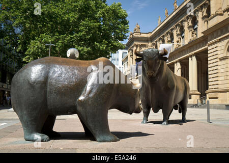 Statues of a bear and bull in front of the Stock Exchange building in Frankfurt - Stock Photo