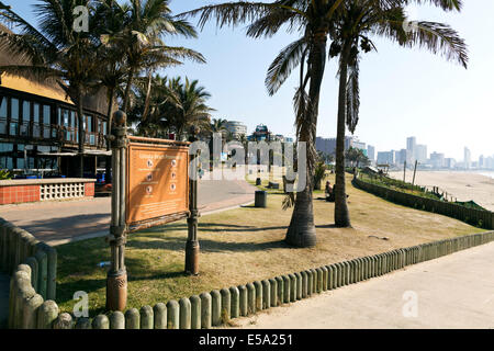 Durban, South Africa. Early morning on Durban's beachfront with Moyo restaurant in the foreground and Ushaka Marine - Stock Photo